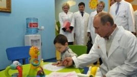 FILE - Russia's President Vladimir Putin visits Lapino clinical hospital in the village of Lapino in Moscow, February 26, 2013.
