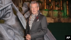 "Actor Sir Ian McKellen poses for photographers upon arrival at the world premiere of ""The Hobbit: The Battle of the Five Armies"" in London, Dec. 1, 2014."