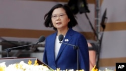 Taiwanese President Tsai Ing-wen delivers a speech during National Day celebrations in front of the Presidential Building in Taipei, Taiwan, Oct. 10, 2021.