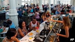 FILE - Crowds gather for Sunday brunch at the renovated St. Roch market in New Orleans, Aug. 16, 2015. After Hurricane Katrina, the city has been helped by billions of dollars in recovery money, buoyed by volunteers and the grit of its own citizens.