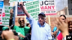FILE - Vermont Sen. Bernie Sanders greets workers at a rally at the University of California Los Angeles, March 20, 2019.
