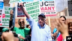 Vermont Sen. Bernie Sanders greets workers at a rally at the University of California Los Angeles, on March 20, 2019.
