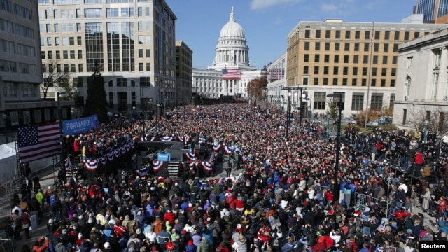 U.S. President Barack Obama addresses thousands in Madison, Wisconsin, November 5, 2012, on his last day of campaigning.
