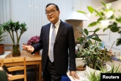 Self-exiled Cambodian opposition party founder Sam Rainsy speaks during an interview with Reuters before his departure to Cambodia via Bangkok on Thursday from his Paris base, France, November 6, 2019.