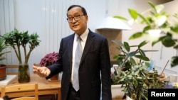 Self-exiled Cambodian opposition party founder Sam Rainsy speaks during an interview with Reuters prior to his departure to Bangkok on Thursday from his Paris base, France, November 6, 2019.