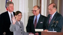 President Bill Clinton watches as Ruth Bader Ginsburg, his nominee for Supreme Court justice, takes the oath of office in 1993