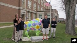 Teacher Kelly Gasior, left, and students, from left, Olivia Mashtaire, Ryan Lysek, Christian Vazquez and Tyler Lysek stand with a statue of a Buffalo that's been emblazoned with anti-bullying messages outside Lorraine Academy, Public School No. 72, in Buf