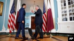 Secretary of State Rex Tillerson waves off questions from the media after shaking hands with ‎Qatari Foreign Minister Sheikh Mohammed bin Abdulrahman Al Thani, June 27, 2017.