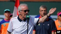 FILE - In this March 20, 2016, file photo, tournament director Raymond Moore gestures while speaking at the BNP Paribas Open tennis tournament in Indian Wells, Calif