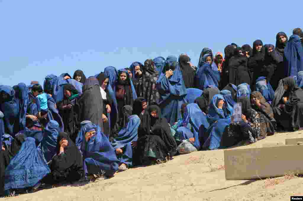 Female Villagers attend the burial ceremony of civilians who were killed by insurgents at Mirza Olang village, in Sar-e Pul province, Afghanistan.