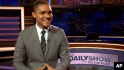 "Trevor Noah appears on the set of his new show, ""The Daily Show with Trevor Noah,"" in New York, Sept. 25, 2015."