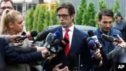 Stevo Pendarovski, a presidential candidate of the ruling coalition led by the Social Democrats, talks to the media outside a polling station after voting in the presidential election in Skopje, North Macedonia, May 5, 2019.