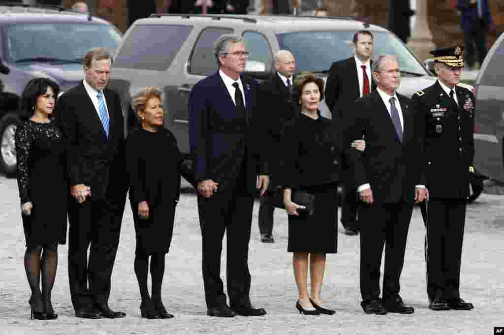 From left, Maria and her husband Neil Bush, Columba Bush, former Florida Gov. Jeb Bush, former first lady Laura Bush and former President George W. Bush arrive for a State Funeral for former President George H.W. Bush at the National Cathedral, Dec. 5, 2018.