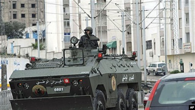 A military armored vehicle in Ettadhamoun, west of Tunis, Jan 12, 2011