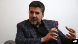 FILE - Rahmatullah Nabil, a former head of Afghanistan's secret service speaks during an interview with the Associated press in Kabul, Afghanistan, May 26, 2016.
