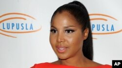 """FILE - This Nov. 1, 2012 file photo shows singer and TV personality Toni Braxton at the Lupus LA's Hollywood Bag Ladies Luncheon in Beverly Hills, Calif. Braxton's autistic son makes his acting debut in her upcoming Lifetime movie """"Twist of Faith."""" (Photo by Katy Winn/Invision/AP, file)"""
