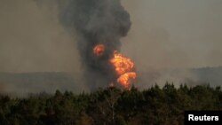 Flames shoot into the sky from a gas line explosion in western Shelby County, Alabama, U.S., October 31, 2016.