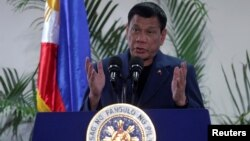 Philippine President Rodrigo Duterte interacts with reporters during a news conference upon his arrival from a four-day state visit to China at the Davao International Airport in Davao city, Philippines, Oct. 21, 2016.