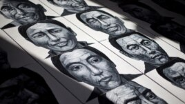 In this photo taken on Dec. 25, 2012, portraits of Tibetans who have self-immolated over the past three years painted by Beijing-based artist Liu Yi are displayed at his studio in Songzhuang art village in Tongzhou, on the outskirts of Beijing.