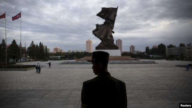 FILE - A soldier stands guard at the doors of the War Museum visited by foreign reporters during a government-organized tour in Pyongyang, North Korea, Oct. 9, 2015.