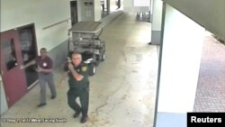 Then-Broward County Sheriff's Deputy Scot Peterson, who was assigned to Marjory Stoneman Douglas High School during the Feb. 14, 2018, shooting, is seen in this still image captured from the school surveillance video released by Broward County Sheriff's Office in Florida, March 15, 2018.