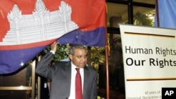 U.N. special rapporteur Surya Subedi walks through a Cambodian national flag upon his arrival in a conference room at the U.N. headquarter in Phnom Penh, file photo.