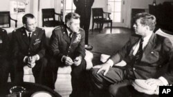 President John F. Kennedy meet with military officers to discuss the U-2 spy plan over Cuba.