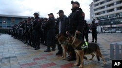 "Albanian police line up in front of Elbasan Arena stadium ahead of Albania's World Cup 2018 qualifying soccer match against Israel under tight security measures in Elbasan, 50 kilometers (30 miles) south of Tirana, Nov. 12, 2016. Police took extreme steps after media reports that an alleged terror group, arrested in Albania, Kosovo and Macedonia, planned an attack during the match. The venue was changed for ""security reasons."""