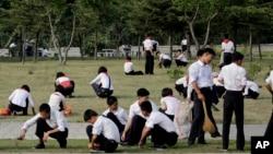 FILE - North Korean school children groom the lawn in Pyongyang, North Korea, June 16, 2017.