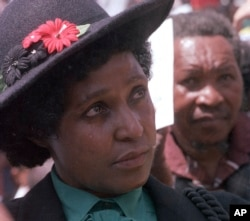 FILE -- In this March 5, 1986 file photo, Winnie Mandela mourns the death of 17 black activists at a funeral service held in Johannesburg, South Africa.