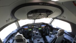 In this Oct. 1, 2012 file photo, the flight deck of a Boeing 787 is shown at Seattle-Tacoma International Airport after it landed on the first day of service on a Tokyo-Seattle route.