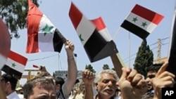 아사드 대통령의 퇴진을 외치는 시리아인들