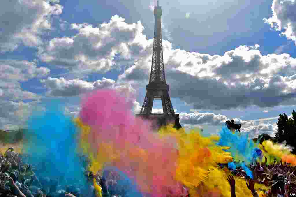 People take part in the Color Run 2017 in front of the Eiffel Tower in Paris, Front.
