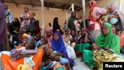 Internally displaced Somali women wait for medicine at a Save the Children UK clinic at their camp in Hodan district of Somalia's capital Mogadishu, Nov. 21, 2012.