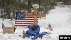 "A memorial for Robert ""LaVoy"" Finicum is seen where he was shot and killed by law enforcement on a highway north of Burns, Ore., Jan. 30, 2016. Four occupiers remain holed up at the Malheur National Wildlife Refuge south of Burns, saying they will not leave without assurances they won't be arrested."