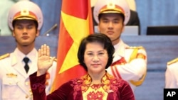Nguyen Thi Kim Ngan takes the oath of office after being elected as chairwoman of the National Assembly in Hanoi, Vietnam Thursday, March 31, 2016.