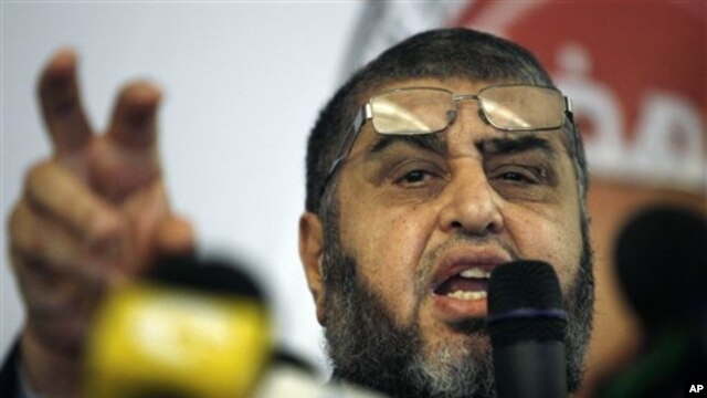 Egypt's Muslim Brotherhood presidential candidate Khairat el-Shater talks to reporters during a press conference in Cairo, Egypt Monday, April 9, 2012.