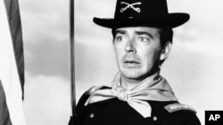 FILE - Ken Berry plays Captain Wilton Parmenter in the F Troop TV series, in one of the show's episodes, July 1, 1965.