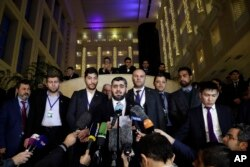 Mohammed Alloush, head of a Syrian opposition delegation, center, speaks to the media after the talks on Syrian peace in Astana, Kazakhstan, Jan. 24, 2017.