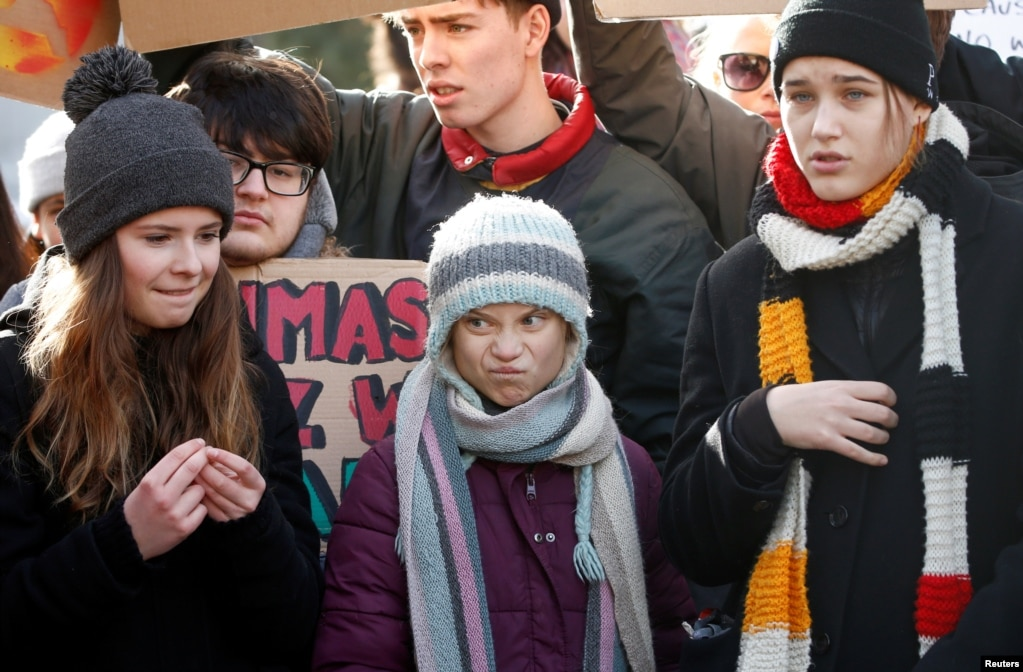 Swedish climate change activist Greta Thunberg, center, takes part in a climate strike protest during the 50th World Economic Forum annual meeting in Davos, Switzerland.