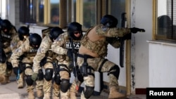 Participants of the European Union Force (EUFOR), Armed Forces, Border Police and State Investigation and Protection Agency (SIPA) of Bosnia and Herzegovina practice an anti-terrorism situation during an exercise at the Sarajevo International Airport, Bos