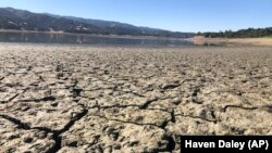 An exposed dry bed is seen at Lake Mendocino near Ukiah, Calif., Wednesday, Aug. 4, 2021. (AP Photo/Haven Daley)