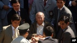 FILE - Paul Schaefer, 83, founder and former leader of a commune-like colony in southern Chile, is wheeled to a corrections vehicle to be transferred to prison, in Santiago, Chile, March 14, 2005.