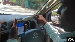 India's new proposed bill on geospatial services could affect taxi drivers and others using maps on their mobiles to guide them to their destination. (A. Pasricha/VOA)