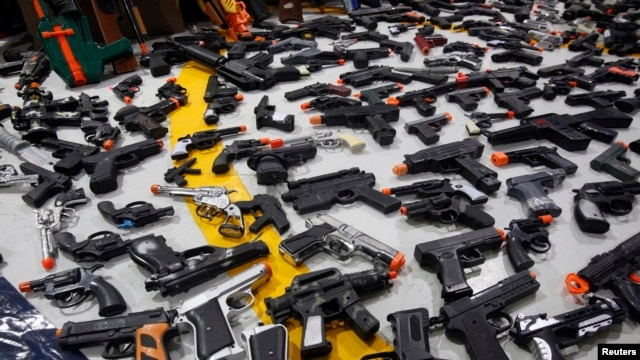 FILE - A collections of toy guns is displayed in a March 4, 2015, photo.