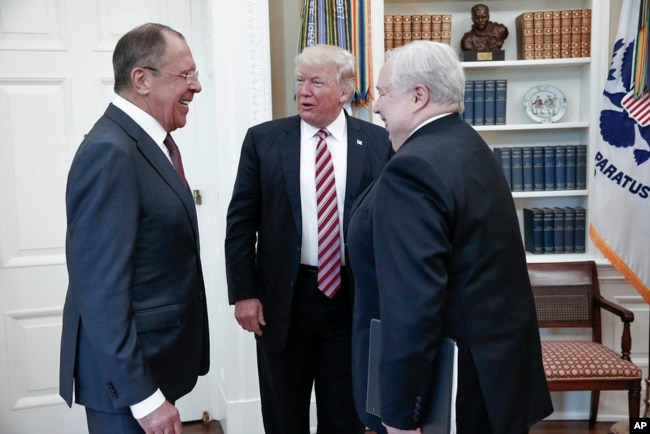 FILE - U.S. President Donald Trump meets with Russian Foreign Minister Sergey Lavrov, left, next to Russian Ambassador to the U.S. Sergei Kislyak at the White House in Washington, May 10, 2017. (Russian Foreign Ministry photo via AP)