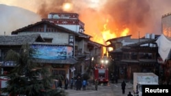 Fire blazes at the Dukezong Ancient Town in Shangri-la county, Yunnan province on Jan. 11, 2014.