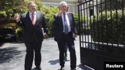 Leader of Greece's Panhellenic Socialist Movement party Evangelos Venizelos (L) and leader of the Democratic Left party Fotis Kouvelis leave the prime minister's office after a meeting in Athens, July 18, 2012.