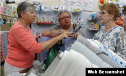 Mary Lee Nielson, shown here helping customers at her business, the Quilted Ceiling in Valley City, North Dakota, is also co-owner of a family farm.