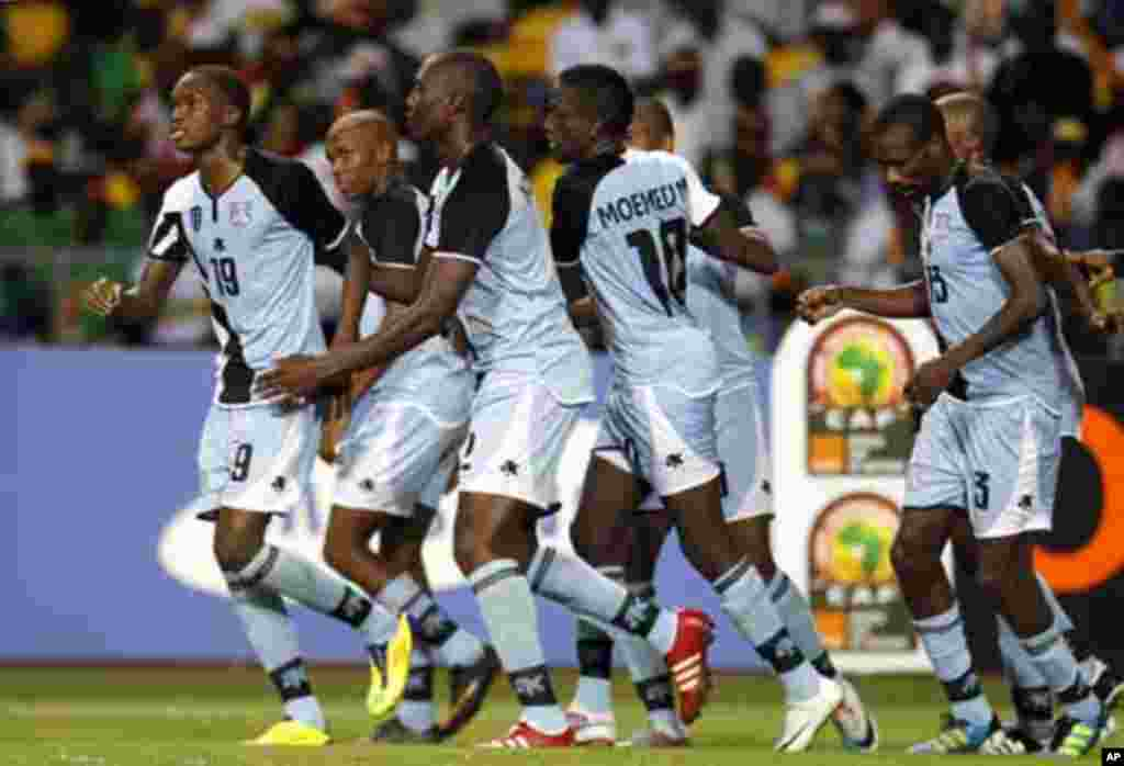 Botswana's Mogakolodi Ngele (L) and his teammates celebrate his goal during their final African Cup of Nations Group D soccer match against Mali at the Stade De L'Amitie Stadium in Libreville February 1, 2012.